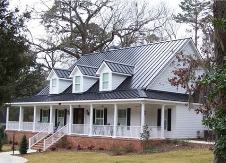 farmhouse with a dark metal roof