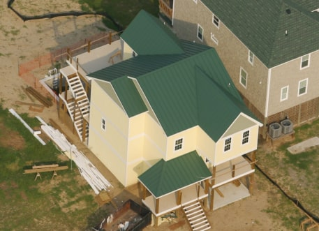 overhead shot of greed metal roofing